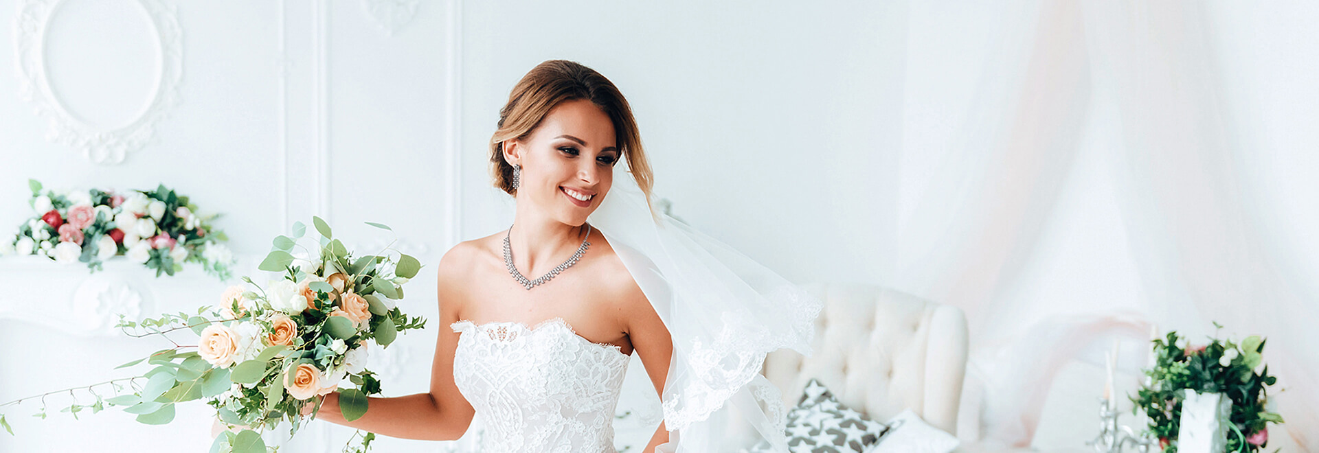 beautiful bride in white dress with bouquet of flower